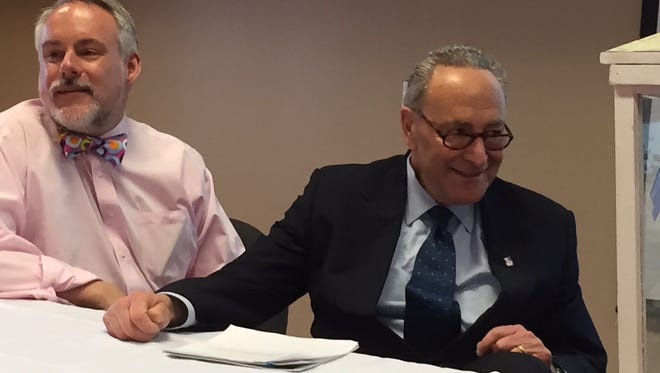 Bruce Darling, left, of the Center for Disability Rights in Rochester, and U.S. Sen. Charles Schumer, D-N.Y., at the Southern Tier Independence Center in Binghamton on Monday. Schumer introduced legislation that he says will make it easier for the developmentally disabled to transition into independent living settings.
