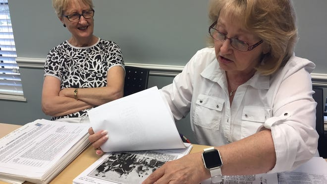 Ellen Stanley (left) watches while Pam Cooper explains her research into how Patriot, the fiberglass horse, ended up in Vero Beach's Pocahontas Park.