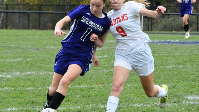 Marshwood High School's Rori Coomey, left, tries to move around Sanford's Isabelle Kallis during a 2018 playoff game.