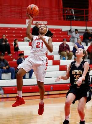 Jeffersonville's Jhala Henry gets past Corydon's Cami Schmitt to get the layup. 