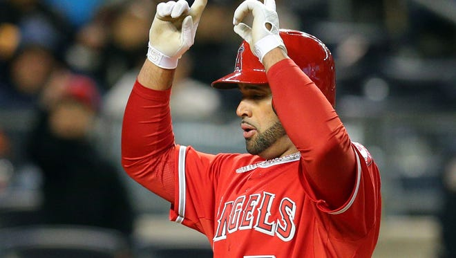 Los Angeles Anglels first baseman Albert Pujols reacts after hitting a solo home run against the New York Yankees during the fifth inning of a game at Yankee Stadium.