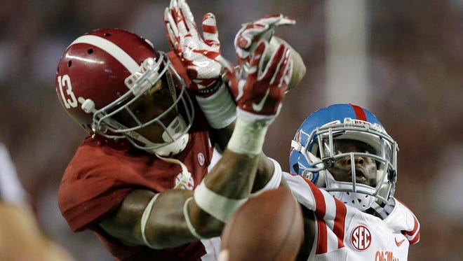 Mississippi defensive back Kailo Moore, left,  breaks up a pass intended for Alabama wide receiver ArDarius Stewart, right, during the second half last Saturday in Tuscaloosa.