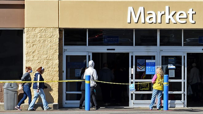 On April 4, 2020, customers enter the Walmart Supercenter at 2711 Elm St., in Erie. Walmart is limiting the number of shoppers allowed in the store at one time to encourage social distancing during COVID-19, the new coronavirus precautions.