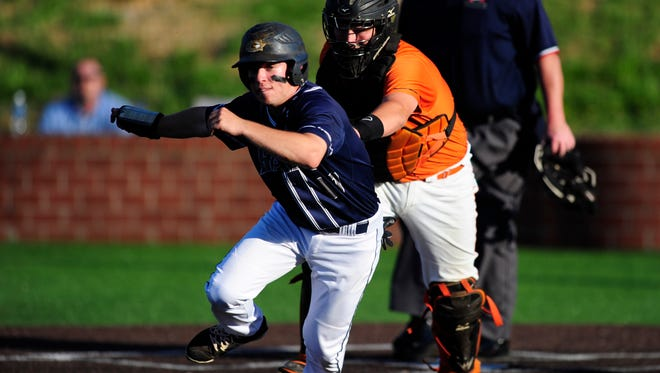 Grace Christian's Hunter Ross (17) is chased from home by Greenback catcher Reese Plemons (10) during the Region 2-A final on Wednesday, May 17, 2017.
