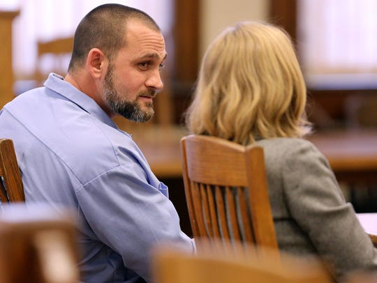 Convicted killer Sean Rhomberg talks to his attorney