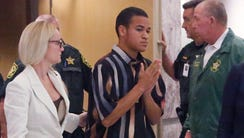 Nikolas Cruz's brother, Zachary Cruz (center), is pictured