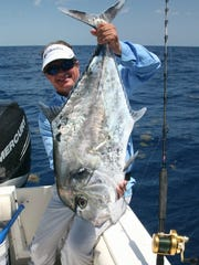 GEORGE POVEROMO/CONTRIBUTED PHOTO African pompano, like this one caught off the Keys by George Poveromo, look nothing like a Florida pompano and are way bigger.