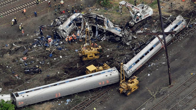 Emergency personnel work at the scene of an Amtrak train derailment on May 13, 2015, in Philadelphia.