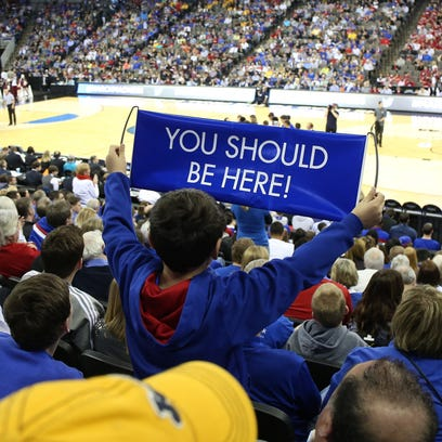 Kansas fans cheer for the Jayhawks against New Mexico