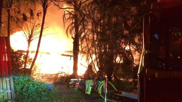 Rescue crews battle a house fire in Jupiter Farms.