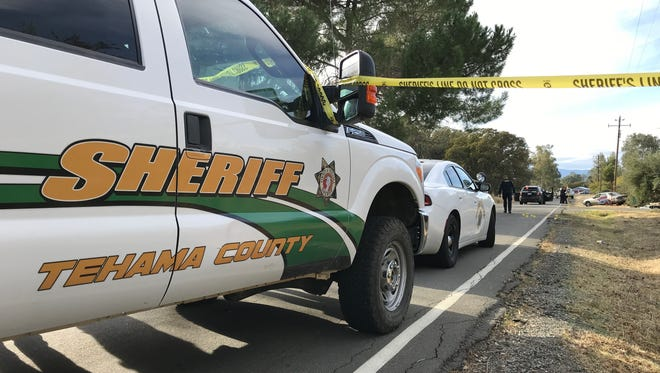 Law enforcement personnel, including the FBI and state Department of Justice, investigate the scene where police and Rancho Tehama shooter Kevin Neal exchanged gunfire Tuesday.