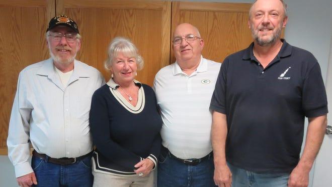 Ken Honold, left, Jo Wahlen,  and Mike Lautenbach with Jacksonport Town Chairman Randy Halstead.