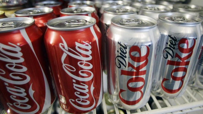 Cans of Coca-Cola and Diet Coke.