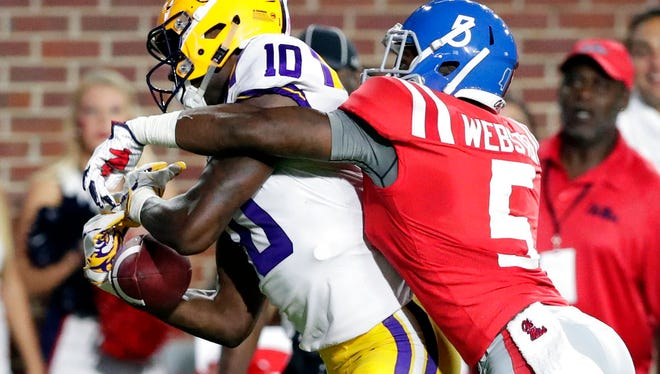 Mississippi defensive back Ken Webster (5) breaks up a pass intended for LSU wide receiver Stephen Sullivan (10) in the first half of an NCAA college football game in Oxford, Miss., Saturday, Oct. 21, 2017. (AP Photo/Rogelio V. Solis)
