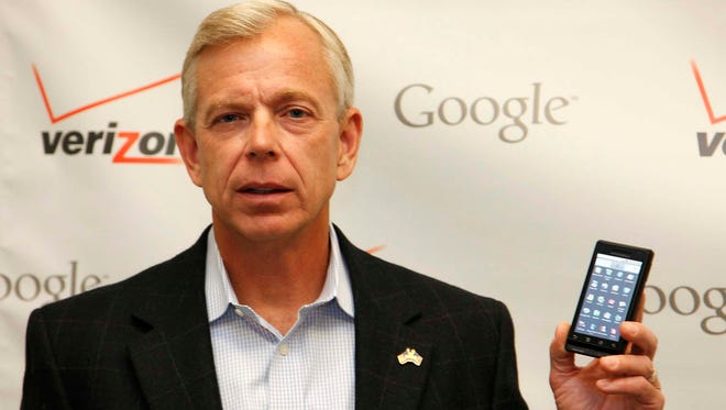 In this Oct. 6, 2009 photo, Lowell McAdam, president and CEO of Verizon Wireless, holds Motorola cell phone containing android software, during  a joint  announcement with Google in New York. (AP Photo/Mark Lennihan) ORG XMIT: NYML101