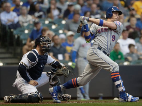 New York Mets' Brandon Nimmo hits a triple during the