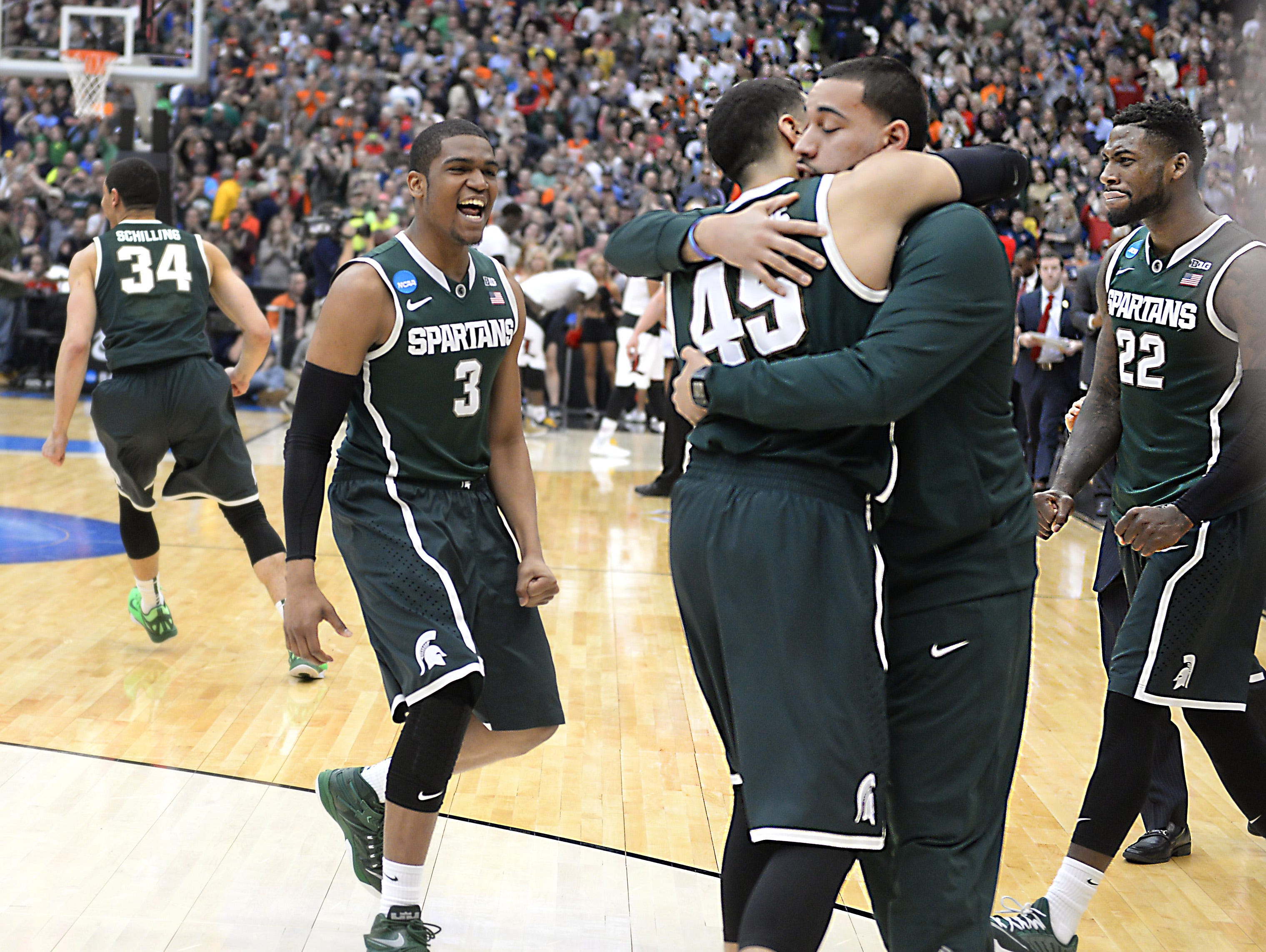 Drew Valentine and Denzel Valentine embrace after Michigan State toppled Louisville to earn a trip to the Final Four.