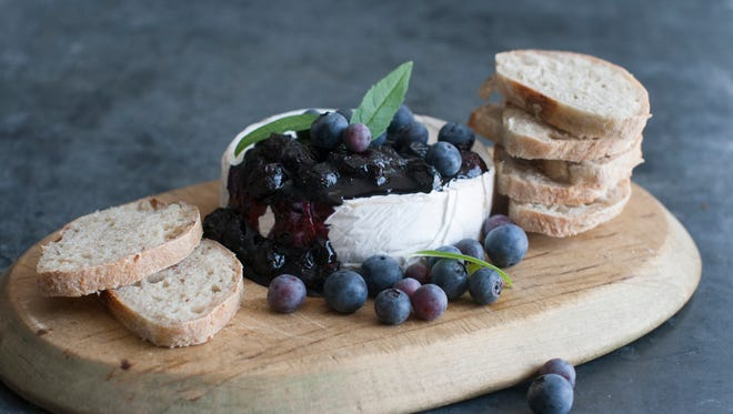 This June 30, 2014 photo shows a blueberry topping over brie in Concord, N.H.