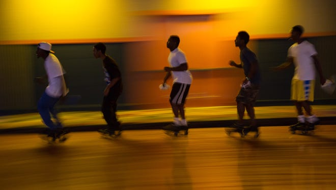 The faster skaters form a line as Magic Wheels celebrates its 30th anniversary on Sunday.
