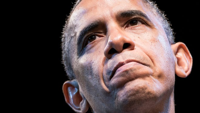US President Barack Obama pauses while speaking at the Town Hall Education Arts Recreation Campus December 4, 2013 in Washington, DC. Obama on Wednesday returned to the core economic philosophy of middle class opportunity on which he has centered his presidency, as he strives to exit a second term slump. The US leader struck economic themes familiar from his two presidential campaigns as he sought to steady his administration after self-inflicted wounds over his health care law which have seen his popularity slide.  AFP PHOTO/Brendan SMIALOWSKI        (Photo credit should read BRENDAN SMIALOWSKI/AFP/Getty Images)