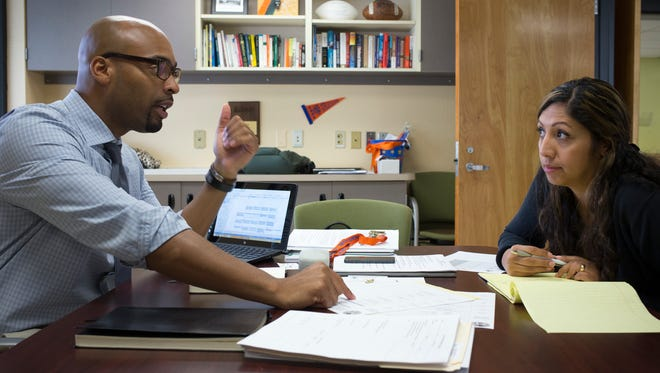 Principal Quintin Boyce talks with Assistant Principal Melissa Jackson at Camelback High. Boyce is one of several newly assigned school principals for 2014-15.