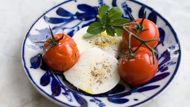 Grilled tomatoes and burrata in Concord, N.H. on May 5, 2014.