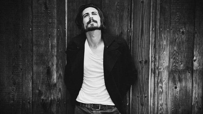 Augustana, featuring Dan Layus, will release a new album, 'Life Imitating Life,' April 22. 'Ash and Ember,' the album's first single, is premiering at USA TODAY.