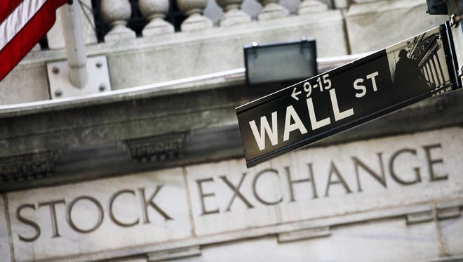 A Wall Street street sign outside the New York Stock Exchange in New York City.