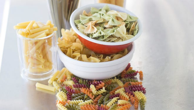 This Sept. 15, 2014 photo shows an assortment of pastas, from top clockwise, Pastene mafaldine 5, Rao's tre-carfalle farfalle, NoYolks dumplings, WackyMac veggie spirals, DeCecco zita cut, DeCecco linquine with spinache in Concord, N.H.