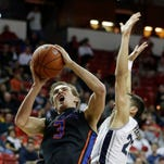 Boise State's Anthony Drmic shoots as Nevada's Mike Perez defends during the first half of their Mountain West Tournament quarterfinal game on Thursday in Las Vegas.