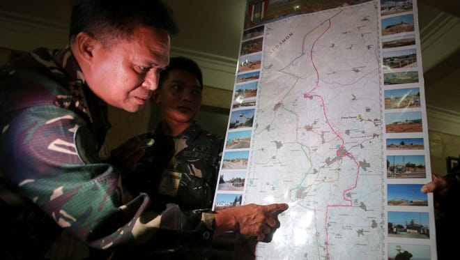 Philippine military chief Gen. Gregorio Pio Catapang shows reporters where Filipino peacekeepers in Golan Heights have been repositioned during a press conference at Camp Aguinaldo military headquarters in suburban Quezon city, Philippines.