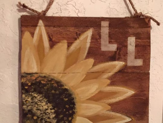 This rustic wooden sign with a sunflower will be the