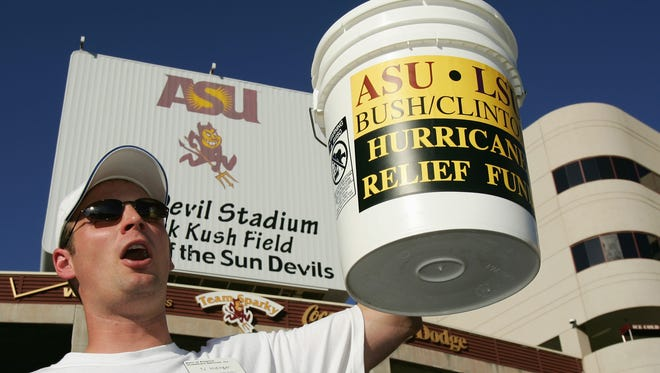 A volunteer collects doantions for Hurricane Katrina Relief Fund before the game between the Arizona State Sun Devils and the Louisiana State University Tigers at Sun Devil Stadium on September 10, 2005 in Phoenix, Arizona.