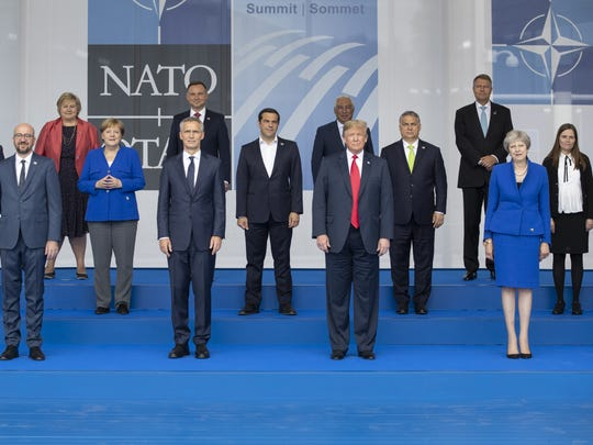 BRUSSELS, BELGIUM - JULY 11: Heads of state and government, including (from L to R, first row) Belgian Prime Minister Charles Michel, NATO Secretary General Jens Stoltenberg, U.S. President Donald Trump and British Prime Minister Theresa May pose for the family photo during the opening ceremony at the 2018 NATO Summit at NATO headquarters on July 11, 2018 in Brussels, Belgium. Leaders from NATO member and partner states are meeting for a two-day summit, which is being overshadowed by strong demands by U.S. President Trump for most NATO member countries to pay more towards funding the alliance.