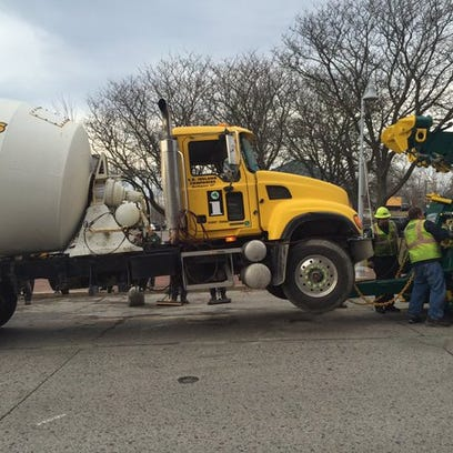 The S.D. Ireland cement truck rolled over while exiting Winooski circle onto Main Street. Pictured on Friday morning, Nov. 27, 2015.