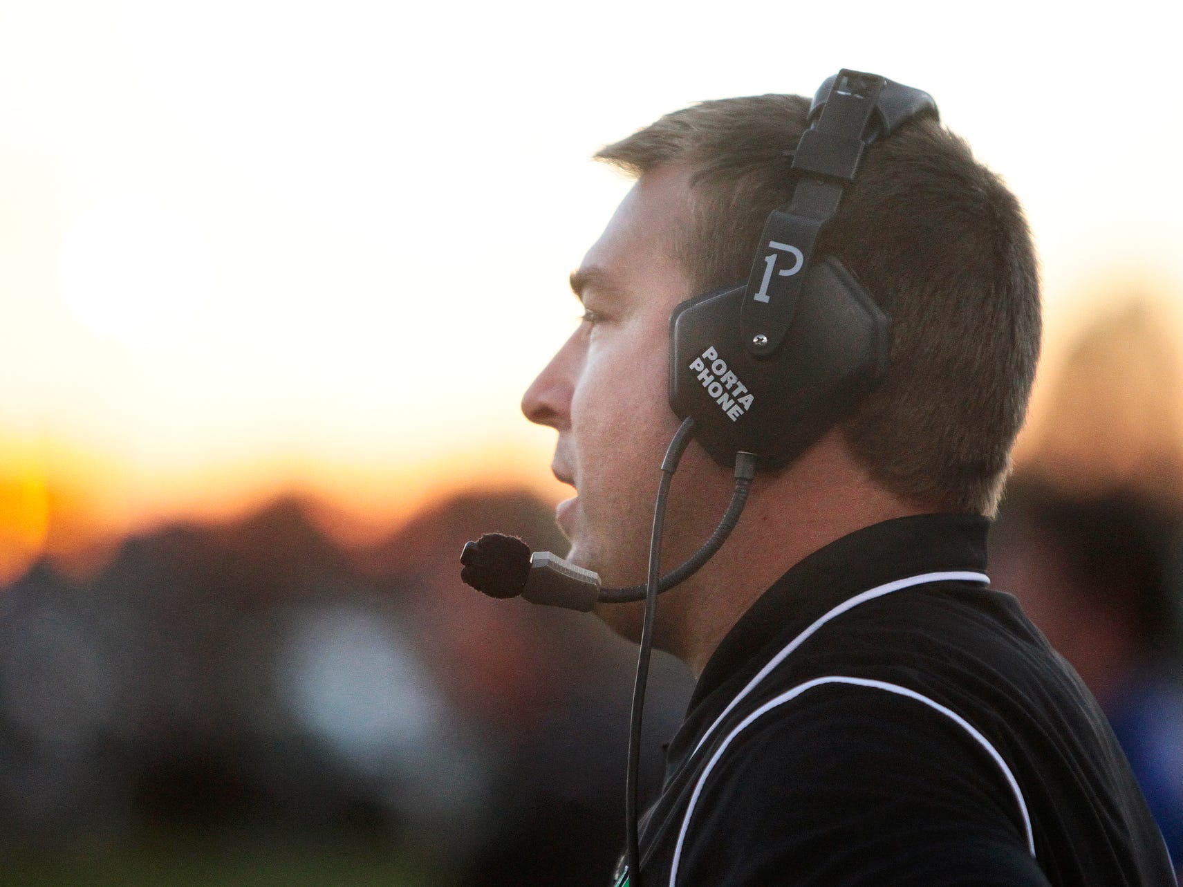 Yorktown head coach Mike Wilhelm yells to his team during their football game against New Palestine Friday, September 27, 2013, at Yorktown.