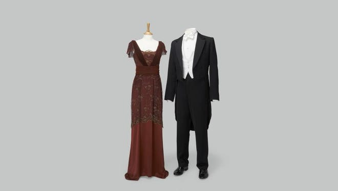 Lady Mary Crawley dark red dress worn at dinner the night of the hunt. Right: Matthew Crawley black tail suit with waistcoat, white shirt, white tie worn at dinner the night of the hunt and for most other formal occasions.