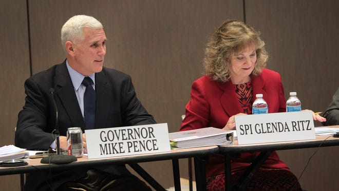Gov. Mike Pence and Superintendent of Public Instruction Glenda Ritz at the Indiana Education Roundtable meeting April 21.