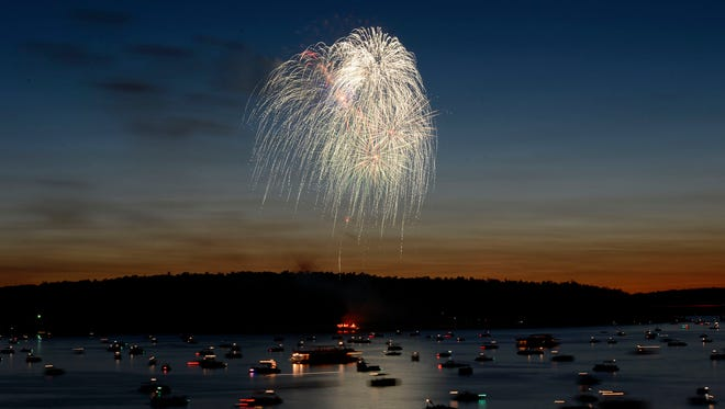 Fireworks explode over Norfork Lake in this July 3, 2014 file photo. Fireworks return to the Twin Lakes Area this weekend.