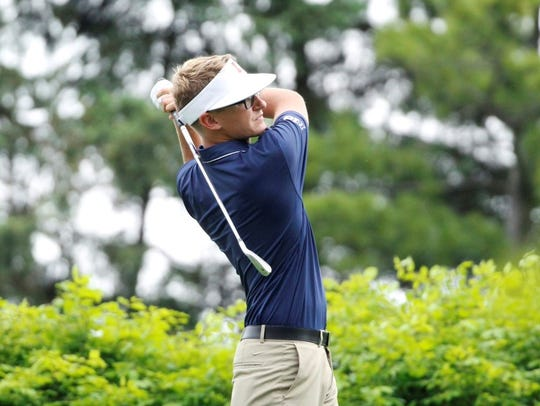 Dylan Meyer stares down a tee shot in the NCAA Regional