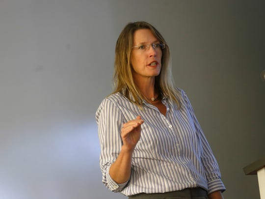 Stephanie Stringer, chief of the New Mexico Environment Department's Drinking Water Bureau, gives a presentation on Monday to members of the Gold King Mine Citizens' Advisory committee at San Juan College in Farmington.