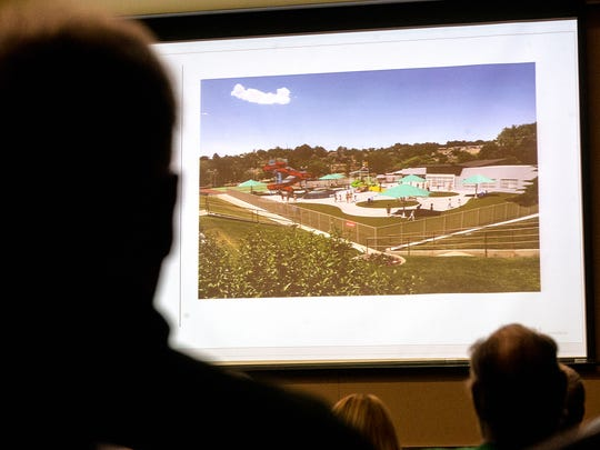 Officials with FBT Architects give a presentation Monday on new designs for Brookside Pool during a community meeting at the Farmington Civic Center.