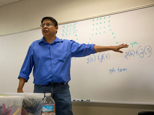 Henry Fowler, a math professor at Diné College, leads a session during a math camp Thursday at Navajo Preparatory School in Farmington.