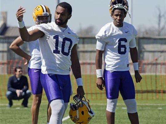 LSU quarterbacks Anthony Jennings (10) and Brandon