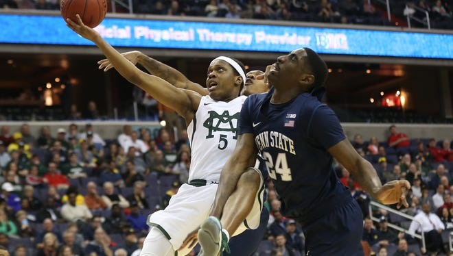 Mar 9, 2017; Washington, DC, USA; Michigan State Spartans guard Cassius Winston (5) shoots the ball as Penn State Nittany Lions forward Mike Watkins (24) defends in the first half during the Big Ten Conference Tournament at Verizon Center. Mandatory Credit: Geoff Burke-USA TODAY Sports