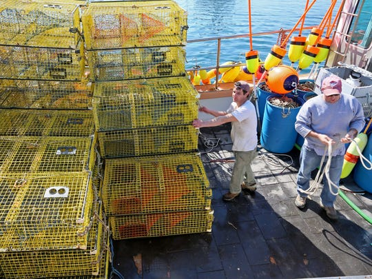 "29 year-old Nick Frontiero helps unload a lobster boat alongside Captain Andy Barlett. ""I could have been a captain by now,"" Frontiero said. But his drug addiction derailed his career. ""I didn't even care. I was so screwed up."""