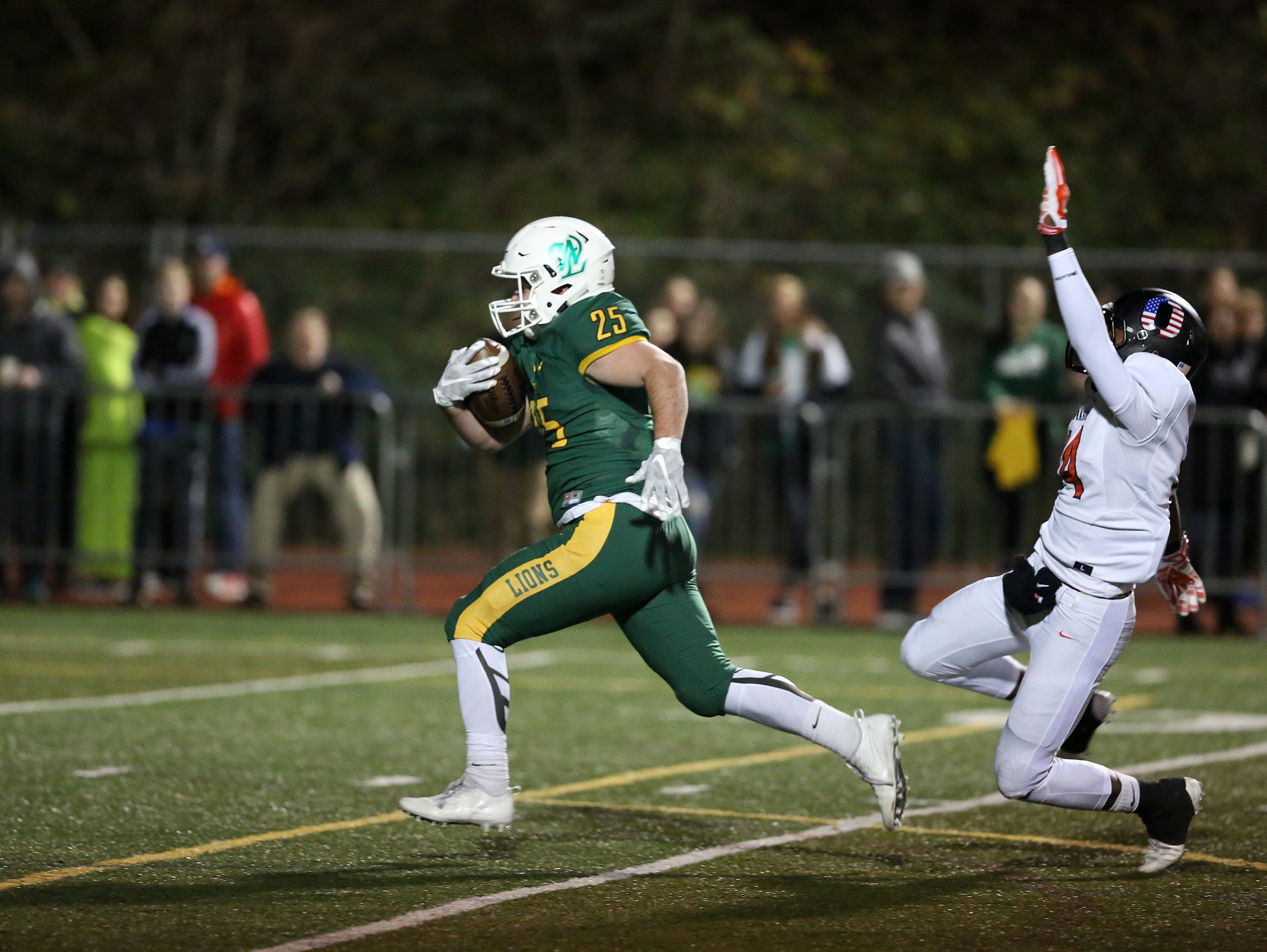 Sprague's Jailen Hammer tries to take down West Linn's Tyler Good as the Olys fall to West Linn 56-20 in the OSAA Class 6A state quarterfinals on Friday, Nov. 18, 2016, at West Linn High School.