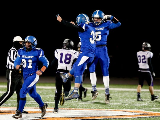 Amherst players celebrate after a touchdown during the Division 5 playoff game between Amherst and Grantsburg on November 10, 2017, at Stanley-Boyd High School in Stanley, Wis.