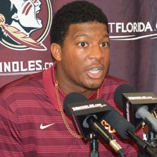 Florida State quarterback Jameis Winston comments on his half-game suspension Wednesday, Sept. 17, 2014,  during a news conference at Florida State University in Tallahassee, Florida. The 2013 Heisman Trophy winner apologized for leaping on a table and shouting obscenities on campus. The university benched him for the first half of Saturday's game against Clemson.
