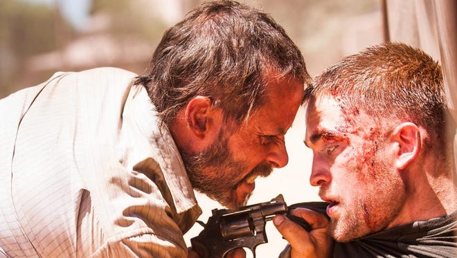 """Guy Pearce and Robert Pattinson in a scene from """"The Rover"""""""
